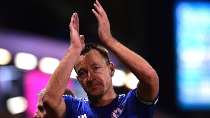 Chelsea's John Terry acknowledges supporters after the Premier League match against Burnley in Burnley on August 18, 2014