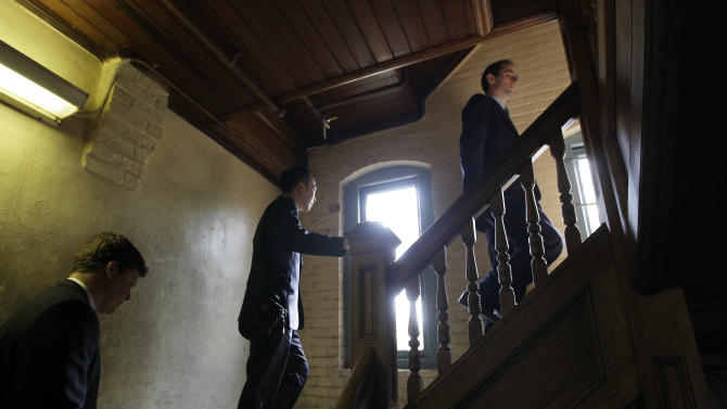 Interested people from Olivet University and the World Evangelical Alliance climb stairs during a tour of buildings on an historic 217-acre campus in Northfield, Mass., in this photo taken Thursday, March 8, 2012. The campus, along with its 43 buildings, is being offered for free to an orthodox Christian group who can come up a solid plan to use it. (AP Photo/Elise Amendola)