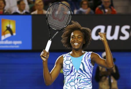 Venus of the U.S. celebrates defeating Radwanska of Poland in their women's singles match at the Australian Open 2015 tennis tournament in Melbourne
