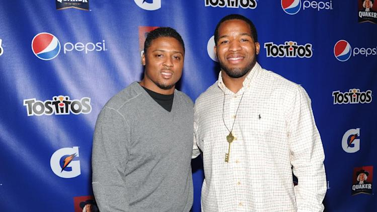 IMAGE DISTRIBUTED FOR PepisCo - From left, former NFL player Warrick Dunn and Alfred Morris of the Washington Redskins attend the PepsiCo Pre-Super Bowl Party, at Masquerade Night Club, on Friday, Feb. 1, 2013 in New Orleans. (Photo by Evan Agostini/Invision for PepsiCo/AP Images)