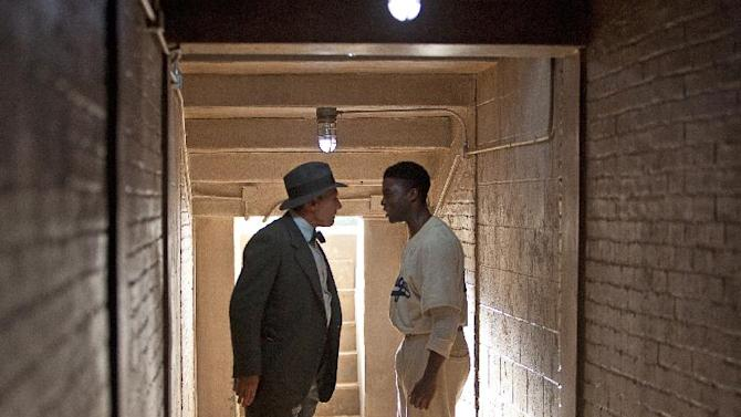 """This film image released by Warner Bros. Pictures shows Chadwick Boseman as Jackie Robinson, right, and Harrison Ford as Branch Rickey in a scene from """"42."""" (AP Photo/Warner Bros. Pictures, D. Stevens)"""