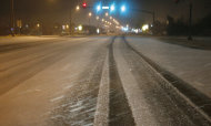 Only a few tire tracks can be seen in the windswept snowfall early Thursday morning, Jan. 17, 2013 on Lakeland Drive, usually a busy street in Flowood, Miss. The National Weather Service says central Mississippi could get from 2 to 4 inches of snow from midnight through midmorning Thursday. (AP Photo/Rogelio V. Solis)