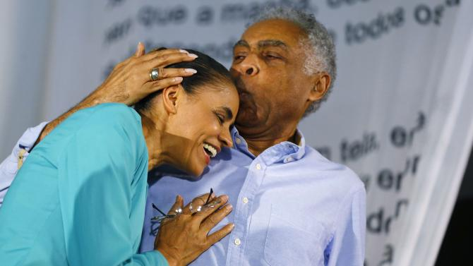 Presidential candidate Marina Silva of the Brazilian Socialist Party is greeted by Brazilian singer Gilberto Gil during a meeting in Rio de Janeiro