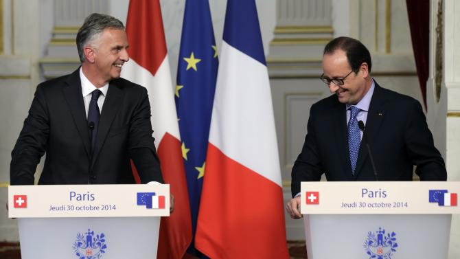 French President Hollande and Switzerland Confederation President Burkhalter attend a news conference at the Elysee Palace in Paris