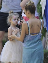 Please excuse us while we partake in plenty of girlie coo-ing and swooning, but how ridiculously cute are these pictures of the gorgeous Nicole Richie and her daughter Harlow?
