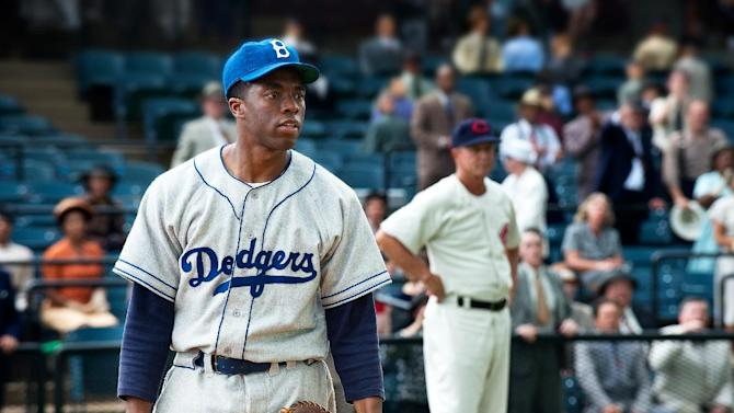 "This film image released by Warner Bros. Pictures shows Chadwick Boseman as Jackie Robinson in a scene from ""42.""  The movie,  about Robinson's, life, is bringing his inspiring story to a new generation. Fans young and old can find a number of places in Brooklyn connected to the baseball great. (AP Photo/Warner Bros. Pictures, D. Stevens)"
