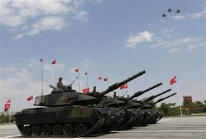 Turkish army tanks and aircrafts take part in a parade marking the 91st anniversary of Victory Day in Ankara
