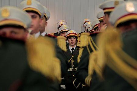 Republican guards sing the national anthem to open the constitutional reforms vote session in Algiers