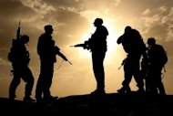 British soldiers are silhouetted against the sky as they provide security in southern Afghanistan. Seven international soldiers have been killed by their local colleagues in a bloody week of violence in Afghanistan, further eroding trust between foreign troops and the Afghans they work with