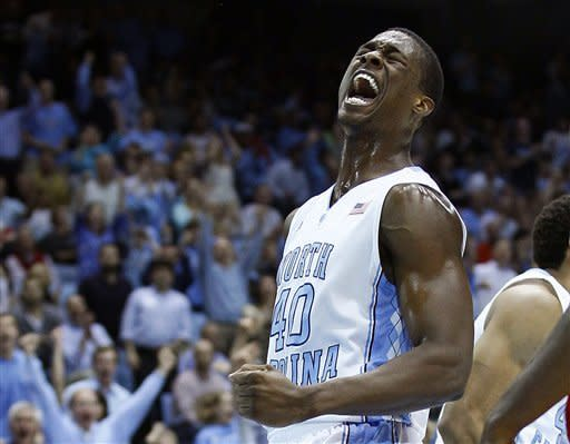 No. 7 North Carolina rolls past NC State 74-55