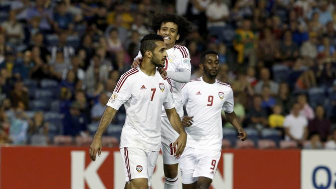 UAE's Ali Mabkhout celebrates his goal with team mates Omar Abdulrahman and Abdulaziz Haikal during their Asian Cup third-place playoff soccer match against Iraq at the Newcastle Stadium in Newcastle
