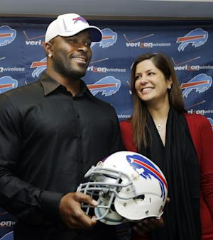 """FILE - In this March 15, 2012 photo, Buffalo Bills' Mario Williams poses for a photo with his fiancee Erin Marzouki smile after an NFL football news conference in Orchard Park, N.Y. Here's one thing that can happen when love goes bad: Bills defensive end Mario Williams is suing his ex-fiancee, demanding she return a $785,000 diamond engagement ring. In response, Marzouki has filed a countersuit, calling Williams' demands """"ridiculous."""" (AP Photo/David Duprey, File)"""