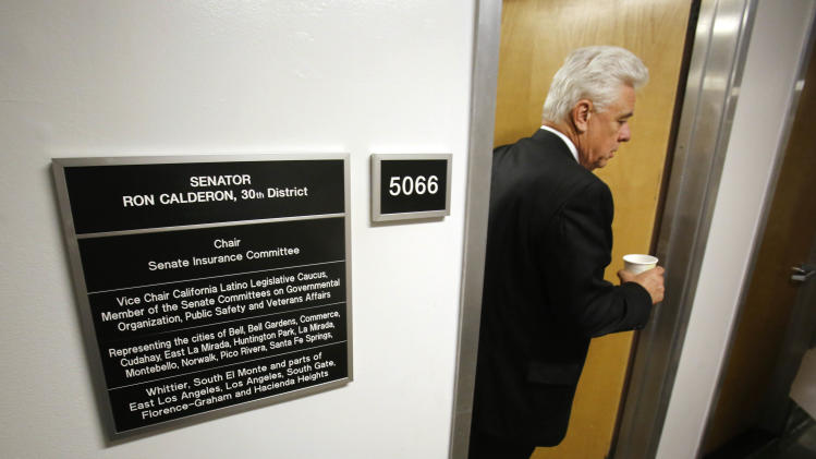 Tony Beard, Chief Sergeant-at-Arms, leaves the Capitol office of state Sen. Ron Calderon, D-Montebello, after checking to ensure the office was secure the day following an FBI raid in Sacramento, Calif., Wednesday, June 5, 2013, Armed with search warrants FBI agents raided Calderon's office and the offices of the Legislatures's Latino caucus, Tuesday. No reason for the search was given. Agents left Calderon's office with several boxes of material.(AP Photo/Rich Pedroncelli)