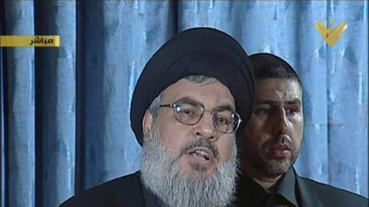 An image grab from Hezbollah's al-Manar TV shows Hassan Nasrallah, the head of Lebanon's militant Shiite Muslim movement Hezbollah, making a rare live appearance from Beirut's southern suburb of Rweiss on November 13, 2013