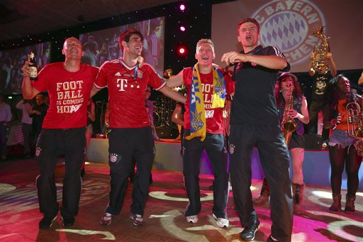 From left, Bayern's Arjen Robben of the Netherlands, Javi Martinez of Spain, Bastian Schweinsteiger and Thomas Mueller celebrate during the Bayern Munich Champions League Finale banquet at Grosvenor H