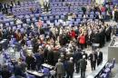 German deputies cast their vote on approval to extend Greece's bailout during session of Bundestag in Berlin