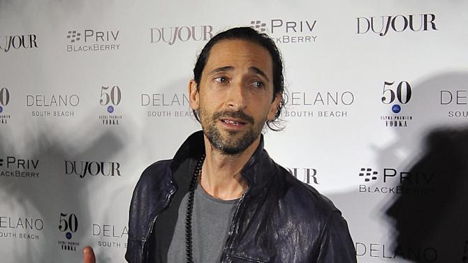 Actor Adrien Brody arrive during the annual Art Basel kick off party presented by Jason Binn publisher of DuJour Magazine at the Delano Hotel, Miami Beach on Tuesday, Dec. 1, 2015, in Miami Beach, Fla. (AP Photo/Gaston De Cardenas)