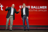 Microsoft CEO Steve Ballmer, left, and Qualcomm CEO Paul Jacobs speak during Jacobs' keynote address at the Consumer Electronics Show, Monday, Jan. 7, 2013, in Las Vegas. (AP Photo/Julie Jacobson)