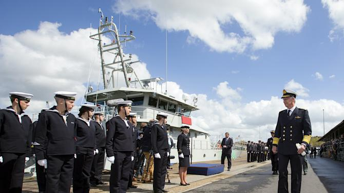 Belgium's King Philippe reviews cadets of the Belgian Navy during the launching of the new Belgian navy patrol ship P902 Pollux in Zeebrugge