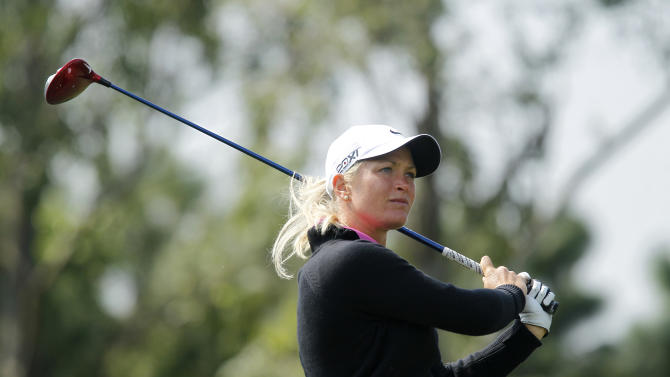 Suzann Pettersen of Norway follows her ball after teeing off on the 3rd hole during the third day of the LPGA Taiwan Championship tournament at the Sunrise Golf and Country Club, Saturday, Oct. 26, 2013, in Yangmei, northern Taiwan. (AP Photo/Wally Santana)