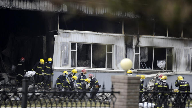 China jails 4 for 2013 fatal fire at poultry plant