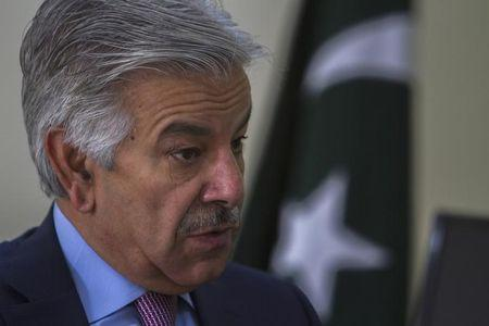 Pakistan's Defence Minister Asif speaks during an interview with Reuters at his office in Islamabad