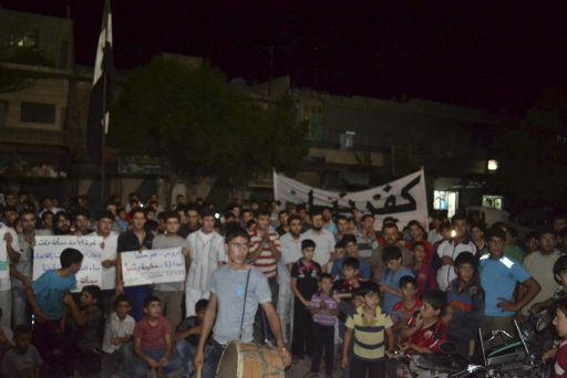 Demonstrators protest against Syria's President Bashar Al Assad in Kafranbel