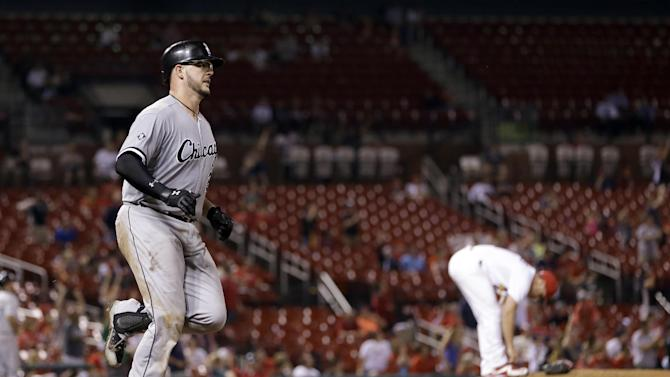 Chicago White Sox's Tyler Flowers, left, rounds the bases after hitting a two-run home run off St. Louis Cardinals relief pitcher Seth Maness, right, during the ninth inning of a baseball game early Thursday, July 2, 2015, in St. Louis. (AP Photo/Jeff Roberson)
