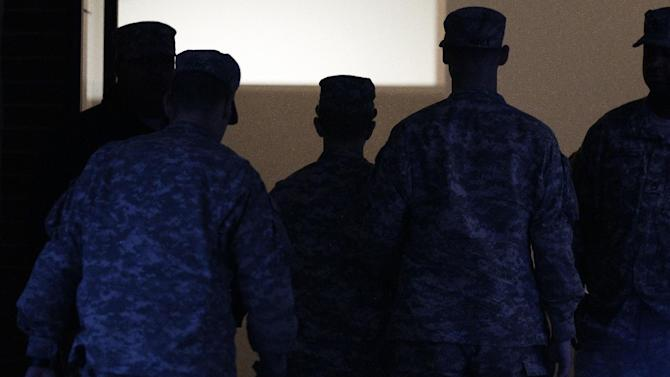 In this Wednesday, Dec. 21, 2011 photo, Army Pfc. Bradley Manning, center, is escorted into a courthouse in Fort Meade, Md., for a military hearing that will determine if he should face court-martial for his alleged role in the WikiLeaks classified leaks case. Visual journalists from many organizations have experienced difficulty capturing an unobstructed view of Manning entering and exiting a courthouse on the U.S. Army Post Fort Meade because of the often heavy security presence around him. (AP Photo/Patrick Semansky)