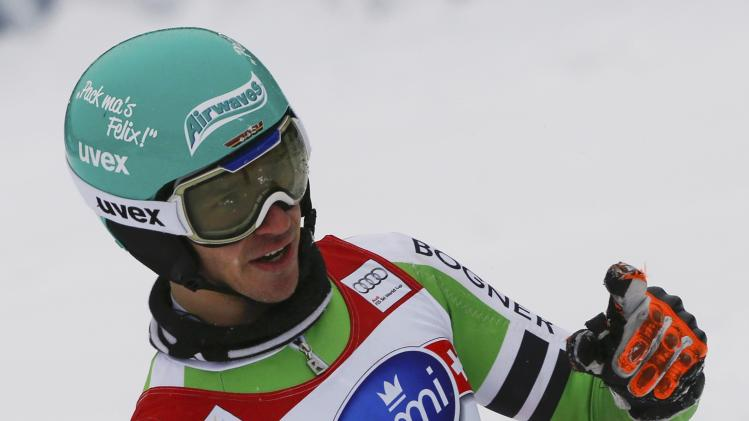 Neureuther of Germany reacts in the finish area during the first run of the men's slalom competition at the FIS Alpine Skiing World Cup Finals in Lenzerheide