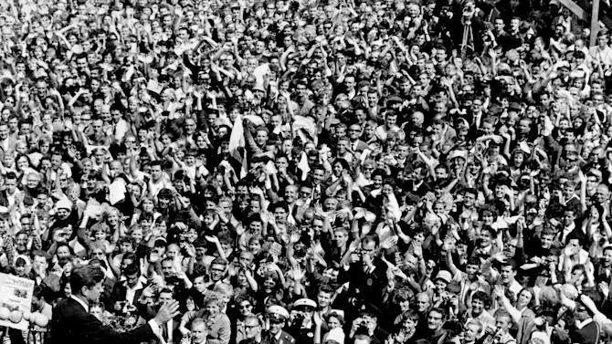 "FILE - In this June 26, 1963 file photo, U.S. President John F. Kennedy, left, waves to a crowd of more than 300,000 gathered to hear his speech where he declared ""Ich bin ein Berliner,"" (""I am a Berliner,"") in the main square in front of Schoeneberg City Hall in West Berlin. (AP Photo/File)"