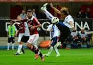 AC Milan's forward midfielder Antonio Nocerino (L) fights for the ball with Atalanta's defender Thomas Manfredini during their Italian Serie A football match at San Siro stadium in Milan. Atalanta won 1-0