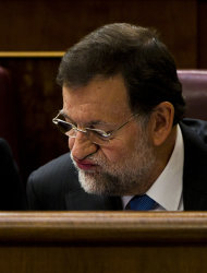 Spain's conservative leader and country's next prime minister Mariano Rajoy reads his notes at the Parliament a month after being elected, in Madrid, Tuesday, Dec. 20, 2011. Spain's Parliament was to vote conservative Popular Party leader Mariano Rajoy as premier later Tuesday. Spain's borrowing costs have plummeted in a short-term debt auction, indicating market confidence in the country's ability to handle its debt is recovering. (AP Photo/Daniel Ochoa de Olza)
