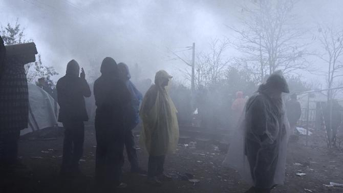 "Migrants demanding to be allowed to pass the Greek-Macedonian border, wait in no-man's land near the northern Greek village of Idomeni, on Wednesday, Nov. 25, 2015. Several European countries, including EU members Slovenia and Croatia and non-members Serbia and Macedonia, have declared they will only allow ""war-zone refugees"" from Afghanistan, Iraq and Syria to transit through their countries on their way to central and northern Europe. (AP Photo/Giannis Papanikos)"
