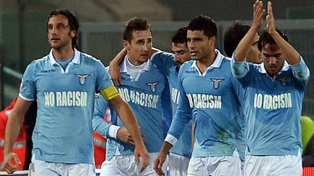 Lazio's German forward Miroslav Klose (2nd L) celebrates with teammates after scoring a goal during the Serie A football match between Lazio and Udinese at Rome's Olympic Stadium