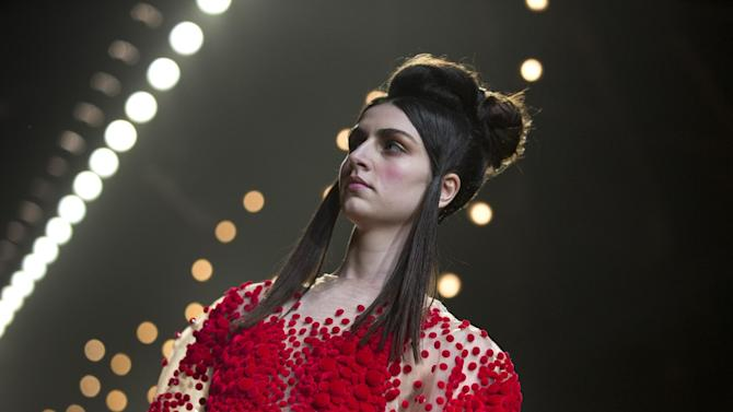 A model wears a creation from Dutch designer Esther Dorhout Mees 2015 collection, presented during Mercedes-Benz Amsterdam Fashion Week, Netherlands, Monday, Jan. 26, 2015. (AP Photo/Peter Dejong)