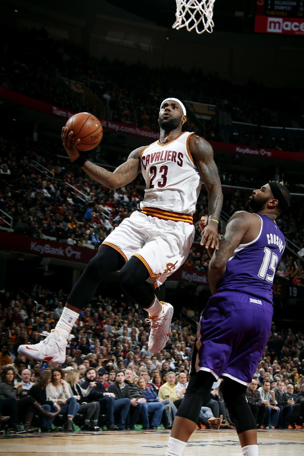 LeBron returns, Love, Irving team for 44, as Cavs top Kings