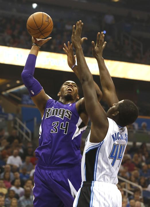 Sacramento Kings forward Carl Landry (24) shoots over Orlando Magic forward Andrew Nicholson (44) during the first half of an NBA basketball game Saturday, Dec. 21, 2013, in Orlando, Fla