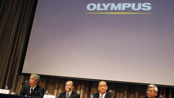 Olympus investors seek $240 million compensation