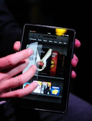 &lt;p&gt;The new Amazon Kindle Fire tablet is seen here at a press conference in New York, in 2011. Kindle Fire proved popular last year, and the small-format Google Nexus 7 joined the Samsung Galaxy in the hot tablet market, dominated by the iPad, which has a screen of nearly 10 inches (24.6 centimeters).&lt;/p&gt;