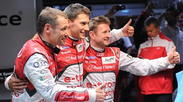 Audi R18 e-tron quattro N°2' drivers Tom Kristensen, Loic Duval, and Allan McNish after qualifying session of the 90th edition of Le Mans 24 hours race (AFP)