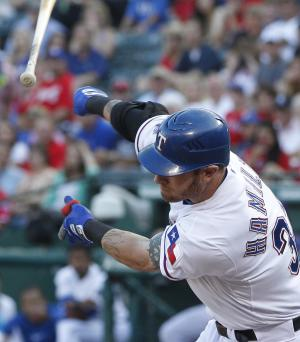 Texas Rangers Josh Hamilton lets go of his bat on a strike-three swing during the first inning of a baseball game against the Arizona Diamondbacks, Tuesday, June 12, 2012, in Arlington, Texas. (AP Photo/LM Otero)
