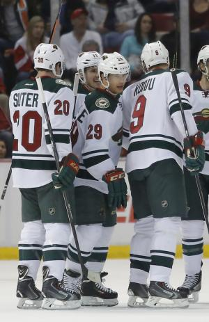 Wild slip past Red Wings 4-3 in OT