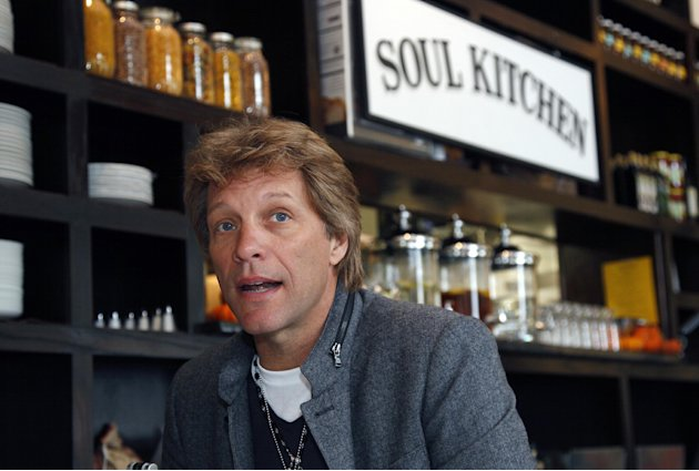 Rock star Jon Bon Jovi sits in the Soul Kitchen restaurant in Red Bank, N.J., Wednesday, Oct. 19, 2011, during the opening of the restaurant which is designed to help the hungry without the stigma of