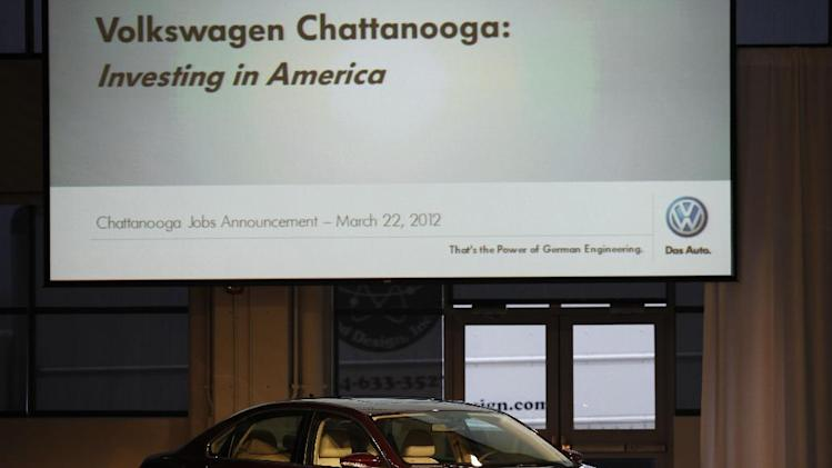 Garrett Jackson, left, and Genaro Vargus polish a Volkswagon Passat before the start of a a news conference on Thursday, March 22, 2012 in Chattanooga, Tenn.  Volkswagen will add 800 new jobs at its Chattanooga plant to boost production of the Passat sedan.  The new jobs will increase the plant's work force to more to 3,500 by the end of the year, the German company said Thursday. The additional workers will be used to bolster the existing two shifts at the plant.  (AP Photo/Chattanooga Times Free Press, Dan Henry)   MANDATORY CREDIT