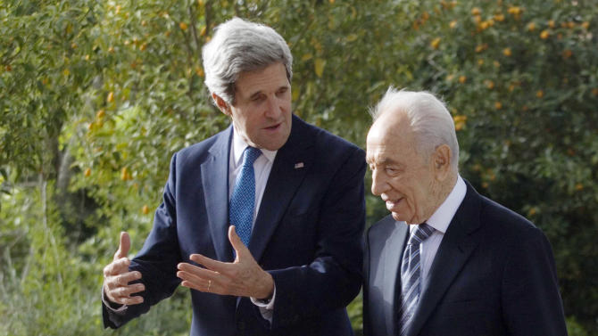 Israel's President Shimon Peres, right, meets with U.S. Secretary of State John Kerry in the President's residence in Jerusalem, Monday, April, 8, 2013. U.S. Secretary of State John Kerry is looking to breathe new life into dormant Mideast peace talks in meetings Monday with Israeli Prime Minister Benjamin Netanyahu and other senior Israeli and Palestinian officials, amid talk of modifying a decade-old Arab plan that's long been greeted with skepticism by the Jewish state. (AP Photo/Dan Balilty, Pool)