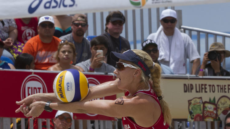 In this photo provided by the World Series of Beach Volleyball, United States' Kerri Walsh Jennings digs the ball during the women's gold medal match at the FIVB Grand Slam at the World Series of Beach Volleyball in Long Beach, Calif.,Sunday July 27, 2014. Walsh Jennings and her partner April Ross defeated Agatha Bednarczuk and Barbara Seixas, of Brazil. (AP Photo/World Series of Beach Volleyball, Holly Stein)