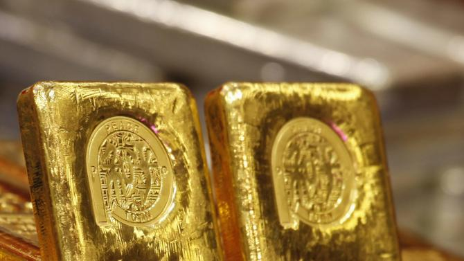 One-kg 24K gold bars are displayed at the Chinese Gold and Silver Exchange Society in Hong Kong