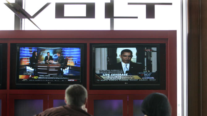 In this photo taken March 30, 2009, file photo General Motors workers view President Barack Obama's talk about the auto industry bailout in Detroit. The government bailout of General Motors and Chrysler is one of the most polarizing issues of the presidential campaign. Many Americans wonder why $62 billion in tax dollars went to keeping the two automakers afloat in 2008 and 2009. There's little doubt the bailout saved the automakers and huge numbers of jobs. But there's also little chance the government will get all its money back.   (AP Photo/Carlos Osorio, File)