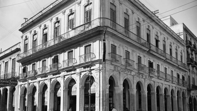 FILE - In this Feb. 15, 1946 file photo, the exterior of the famous Sloppy Joe's Bar stands opposite the reporters club in Havana, Cuba. Sloppy Joe's will be reopened in February 2013 by the state-owned tourism company Habaguanex, part of an ambitious revitalization project by the Havana City Historian's Office, which since the 1990's has transformed block after block of crumbling ruins into rehabilitated buildings along vibrant cobblestone streets.  Sloppy Joe's was founded in 1918 by a Galician immigrant named Jose Abeal Otero who purchased a grocery store in Old Havana after years of tending bar in New Orleans and Miami. Legend has it the sobriquet comes from the place's grubbiness and Abeal's American nickname, Joe. (AP Photo, File)